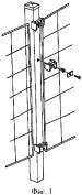 Заборный столб и установленный на нем забор