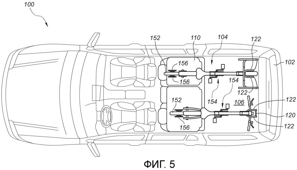 Система крепления велосипеда для грузовой области моторного транспортного средства (варианты) и моторное транспортное средство, содержащее такую систему (варианты)